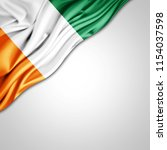 ivory coast flag of silk with... | Shutterstock . vector #1154037598