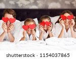 Stock photo happy family relaxing in hotel room 1154037865