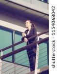 modern businesswoman enjoying...   Shutterstock . vector #1154068042