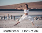 young woman doing yoga in the... | Shutterstock . vector #1154075902