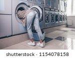 female feet in the washing... | Shutterstock . vector #1154078158