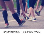 healthy runners team warming up ... | Shutterstock . vector #1154097922