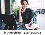 positive clever hipster girl... | Shutterstock . vector #1154106985