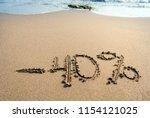 inscription on the sand minus...   Shutterstock . vector #1154121025