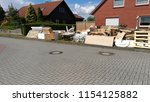 bulky waste on the street is... | Shutterstock . vector #1154125882