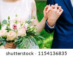 husband and wife in blue suit... | Shutterstock . vector #1154136835