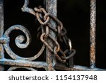 rusty chain with padlock on the ... | Shutterstock . vector #1154137948
