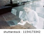 concentrated student doing...   Shutterstock . vector #1154173342