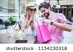 coffee break after shopping.... | Shutterstock . vector #1154230318