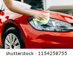woman cleaning car with... | Shutterstock . vector #1154258755