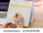 student writing on calendar on... | Shutterstock . vector #1154294938