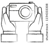 hand with camera photographic   Shutterstock .eps vector #1154333308