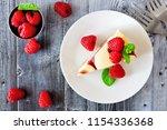 slice of raspberry cheesecake... | Shutterstock . vector #1154336368