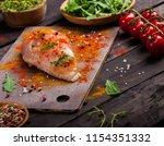 board with raw chicken fillet...   Shutterstock . vector #1154351332