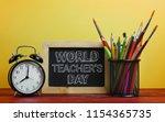 world teacher's day text. alarm ... | Shutterstock . vector #1154365735