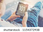 101 with man using a tablet in... | Shutterstock . vector #1154372938