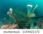 an abandoned ghost fishing net... | Shutterstock . vector #1154421172
