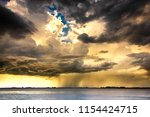 thunderstorm weather at the... | Shutterstock . vector #1154424715