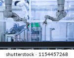 3d rendering robot arm with... | Shutterstock . vector #1154457268