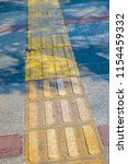 tactile paving  a system of... | Shutterstock . vector #1154459332