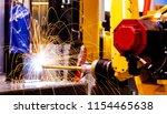 motion welding robots in... | Shutterstock . vector #1154465638