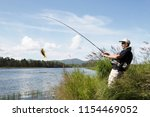 fishing. men fishes on the... | Shutterstock . vector #1154469052