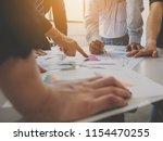 group of businessman meeting... | Shutterstock . vector #1154470255