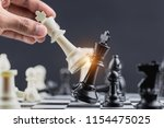 the king in battle chess game... | Shutterstock . vector #1154475025