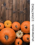 Many Orange Pumpkins On Wooden...