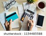 young woman checking bills ... | Shutterstock . vector #1154485588