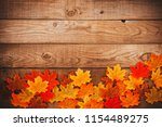autumn maple leaves over old... | Shutterstock . vector #1154489275