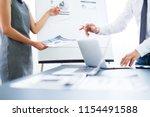 asian business adviser meeting...   Shutterstock . vector #1154491588