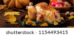 roasted turkey garnished with... | Shutterstock . vector #1154493415
