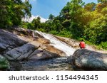 water fall with photographer... | Shutterstock . vector #1154494345
