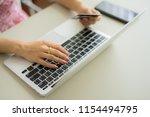 woman hands holding credit card ... | Shutterstock . vector #1154494795