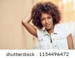 young black woman  afro... | Shutterstock . vector #1154496472