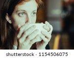 closeup portrait of pensive...   Shutterstock . vector #1154506075