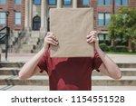 student holding kraft paper... | Shutterstock . vector #1154551528