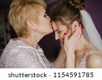 Bride On Wedding Day Holding...