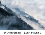 Forested Mountain Slope In Low...