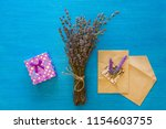 a bouquet of dry lavender and... | Shutterstock . vector #1154603755