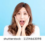closeup surprised young woman... | Shutterstock . vector #1154663098