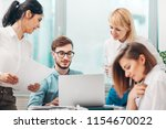 young intern receives feedback...   Shutterstock . vector #1154670022