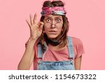 Surprised Female Hippy Wears...