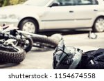 dead motorcyclist on the road... | Shutterstock . vector #1154674558