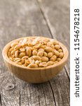salted roasted peanuts in bowl. | Shutterstock . vector #1154678218