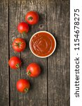 tomatoes and ketchup on old... | Shutterstock . vector #1154678275