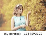 young girl on a walk in the...   Shutterstock . vector #1154693122