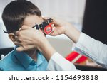 optometrist selects glasses for ... | Shutterstock . vector #1154693818