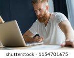 handsome businessman working... | Shutterstock . vector #1154701675